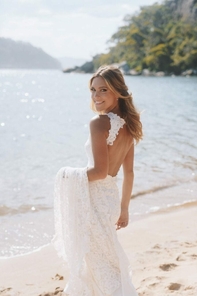 Bride next to a beach, in a white gown