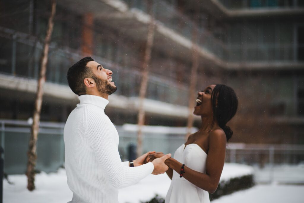 Bride and groom, dancing with falling snow