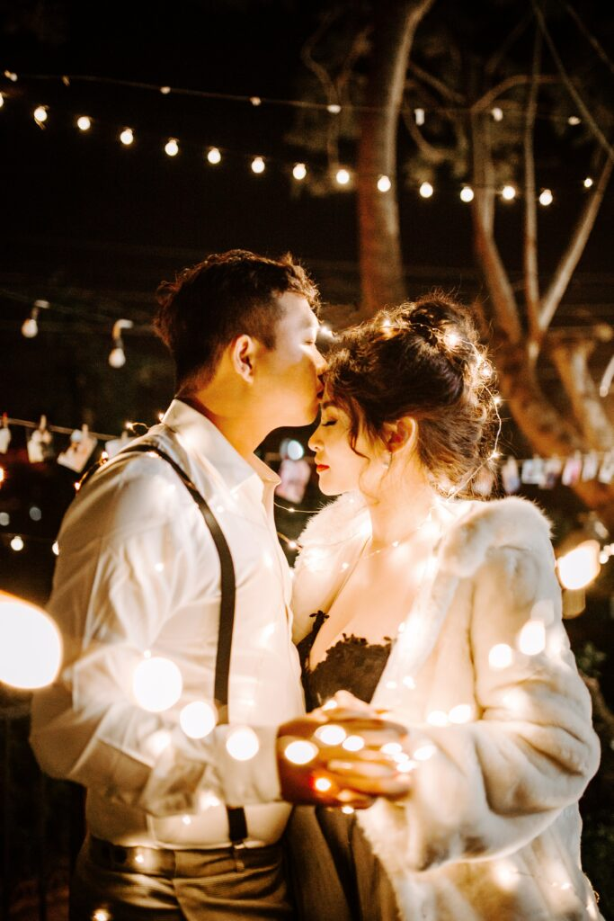 a bride and groom dance with lights, winter wedding