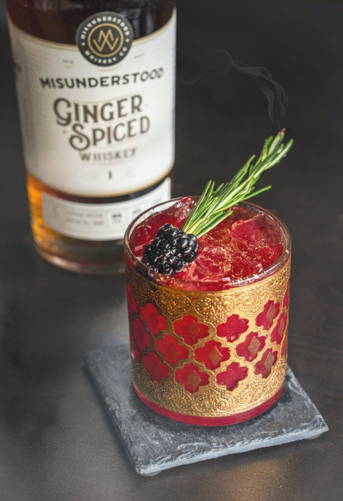 Ginger spiced rum blood colored cocktail.